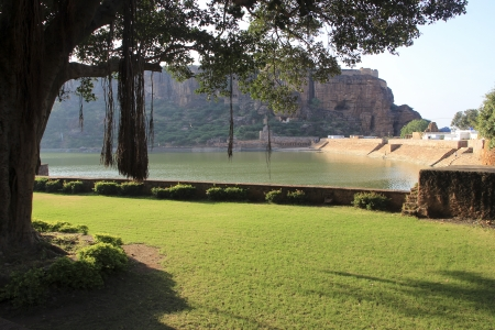 Landscaped garden, Agasthya Teertha Lake and southern cave temple hill at Badami, Karnataka, India, Asia photo