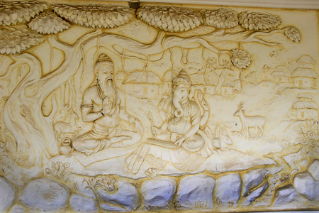 mahabharata: Wall panel at Shaktinagara Gopalakrishna Temple depicting Maharishi  Vyas dictating story of epic Mahabhatata to Ganesha, Mangalore, Karnataka, India, Asia Editorial