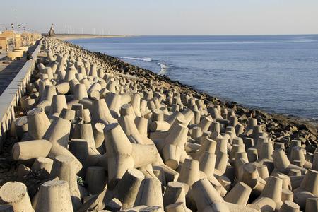 precast: Dumping precast concrete blocks to prevent sea erosion at Port Beach, Dwaraka, Gujarath, India, Asia