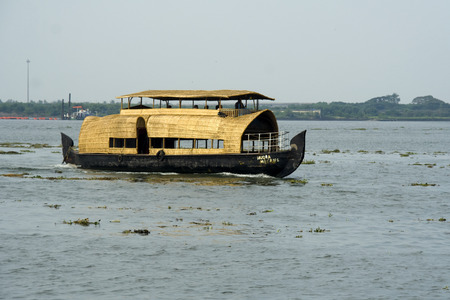 sightseers: Boat house made of bamboo sticks and mats for carrying tourists