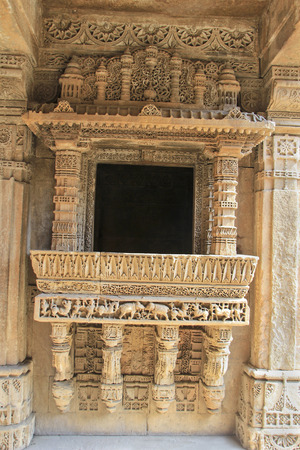 step well: Highly decorative, etched stone balcony at Adalaj Step Well in Ahmedabad, Gujarat, India, Asia