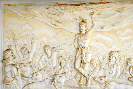 Bas relief sculpture of Lord Krishna lifting mountain Govardhangirii at Shaktinagara Gopalakrishna Temple, Mangalore, Karnataka, India, Asia Stock Photo