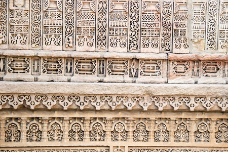 step well: Beautiful, intricate, miniature carving on wall at Adalaj Step Well, Ahmedabad, Gujarat, India, Asia Stock Photo