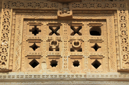 Holes of different geometrical pattern in stone window at Vijay Sthambh  Victory Tower , Chittorgarh Fort, Rajasthan, India, Asia