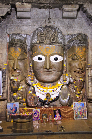 mahadev: Three faces of Lord Shiva symbolizing truth, splendor and anger at Samidheswar Mahadev Temple situated south of Victory Tower, Chittorgarh Fort, Rajasthan, India, Asia