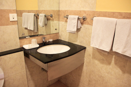 prevailing: Modern bathroom furnished with wash basin, mirror and towel rods