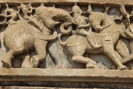 Sculpture of war scene with fighters riding on elephant and horse, Samidheswara Temple, Chittorgarh Fort, Rajasthan, India, Asia photo