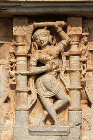 chittorgarh fort: Nicely poised sculpture of maid servant on wall pane at Vijay Sthambh (Victory Tower), Chittorgarh Fort, Rajasthan, India, Asia