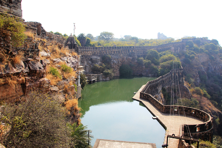 chittorgarh fort: Deep tank filled by a spring coming from cow mouth, situated at the edge of the cliff at Chittorgarh Fort, Rajasthan, India, Asia Stock Photo