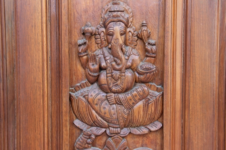 teakwood: Bas relief etching of Ganesha on teakwood door panel