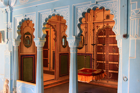 d cor: Interior of palace with cushioned swing seat at City Palace, Udaipur, Rajasthan, India, Asia Editorial