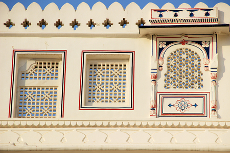 cutouts: View of windows with geometrically shaped cut-outs on wall of Junagarh Fort, Bikaner, Rajasthan, India, Asia