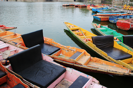 eye traveller: Attractive, colorful row boats waiting for tourists at Nakki Lke, Mount Abu, Rajasthan, India, Asia