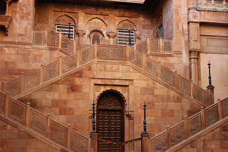embedded: Red stone structure with twin staircases and embedded doors and windows at Junagarh fort, Bikaner, Rajasthan, India, Asia Editorial