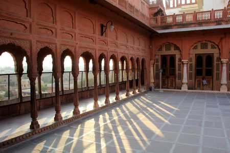 verandah: Interesting pattern caused by evening sunlight at verandah of Junagarh Fort at Bikaner, Rajasthan, India, Asia Stock Photo