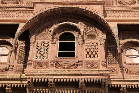 decorative balcony: Close-up of highly decorative carving of balcony at Meharongarh Fort in Jodhpur, Rajasthan, India, Asia