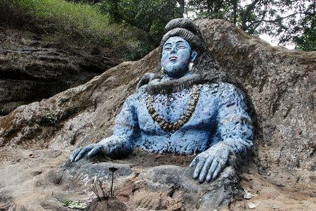 Rock-cut and blue painted carving of Shiva, also known as Jata Shankar, near Jata Shankar Cave, Pachmarhi, Madhya Pradesh, India, Asia Stock Photo - 42011244