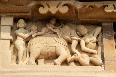 madhya pradesh: Interesting wall carving of ladies with playful elephant at Kandariya Mahadev Temple, under Western Group of Temples in Khajuraho, Madhya Pradesh, India, Asia Stock Photo