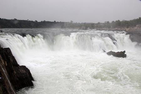 madhya pradesh: White, misty, snow like water at Dhuadhar Water Falls, Bedaghat near Jabalpur, Madhya Pradesh, India, Asia