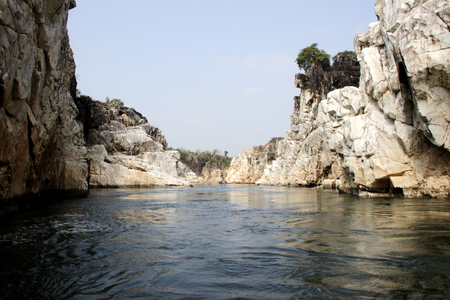 River Narmada flanked by Marble Rocks on either side at Bedaghat near Jabalpur, Madhya Pradesh, India, Asia