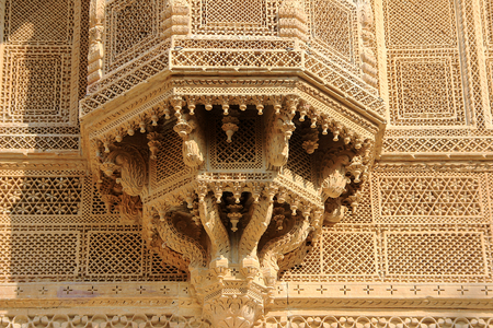 balcony window: Highly intricate and minute decorative pattern of window balcony at Patawon-ki-Haweli in Jaisalmer Fort, Jaisalmer, Rajasthan, India, Asia Stock Photo