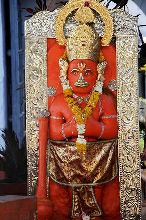 madhya: Vermilion painted and decorated idol of Anjaneya at Ram Mandir in Mandu, Madhya Pradesh, India, Asia