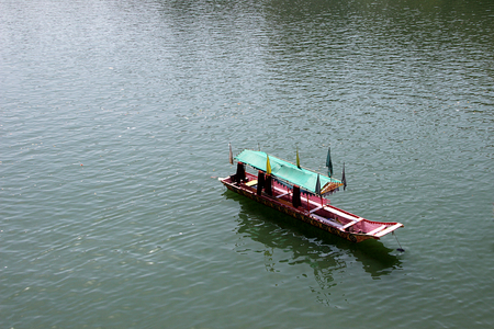 canopy: Tourist boat with shaded canopy waiting for occupation