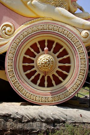 ashram: Close-up of beautifully sculptured wheel of Arjuna�s chariot at Viswashanti Ashram, near Bengaluru, Karnataka, India, Asia Stock Photo