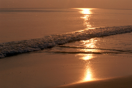 tinge: Reddish tinge and golden yellow sunset glow at Radhanagar Beach, Havelock Island, Andaman, India, Asia