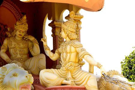 prudent: Statue of Lord Krishna encouraging gloomy Arjuna with his wise sermon at Viswashanti Ashram, near Bengaluru, Karnataka, India, Asia Stock Photo