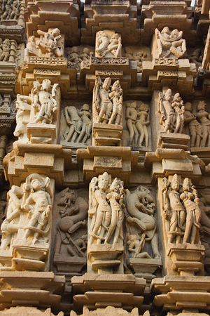 madhya pradesh: Details of sculptures on wall at Jain Temple in Khajuraho, Madhya Pradesh, India, Asia