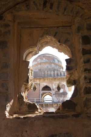 madhya: Tower of Jahaz Mahal, viewed through a broken window, at Mandu in Madhya Pradesh, India, Asia