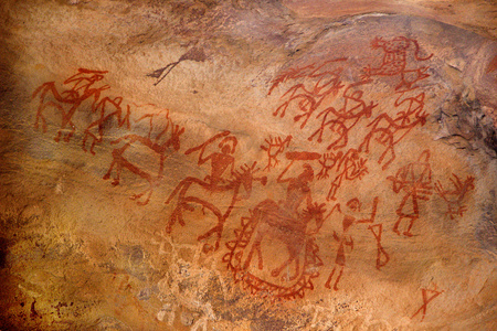 Paintings on wall of caves are the indication of artistic talent expressed by primitive cave dwellers at Bhimbetka near Bhopal in Madhya Pradesh, India, Asia Stock Photo - 57048841