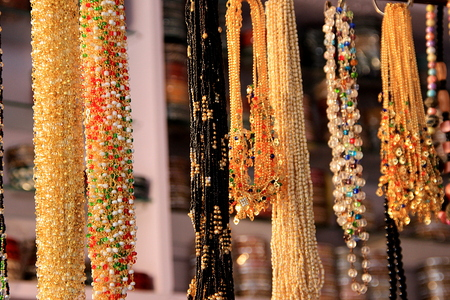 Variety of bead necklaces on display for sale at a fancy store Stock Photo