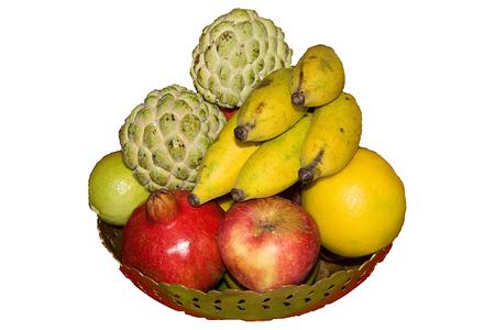 custard apples: Fruit bowl of brass containing apple, pomegranate, sweet lemon, lemon, bananas and custard apples isolated on white