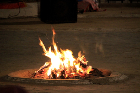 ignited: Yellow and red, hot flames at winter campfire