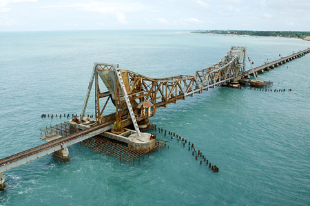 Pamban Railway Bridge near Rameshwaram in Tamil Nudu which can open up to allow ships to pass through below, India, Asia