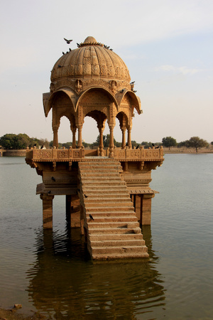 dais: Arched, domed and decorative canopy on stone platform at Gadisar Lake, Jaisalmer, Rajasthan, India, Asia
