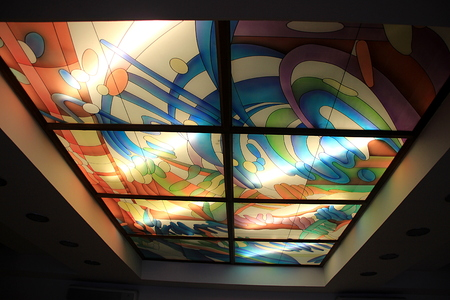 lampshades: Panels of painted design serving as decorative shades with tube lights behind