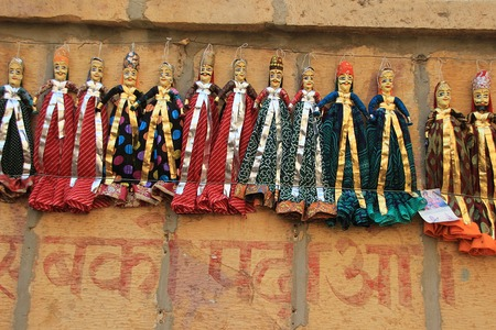 colourfully: Dolls of colourfully dressed Rajasthani Couple displayed on wall at Jaisalmer Fort in Jaisalmer, Rajasthan, India, Asia Stock Photo