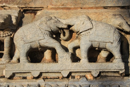 Stone carving of two elephants in combat at Jagadeesh Temple, Udaipur, Rajasthan, India, Asia