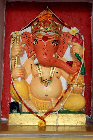 Idol of Ganesha decorated with painting at City Palace, Udaipur, Rajasthan, India, Asia