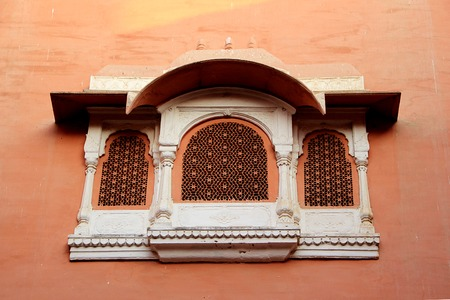 casement: Concrete window frame with intricate design on red wall at Junagarh Fort, Bikaner, Rajasthan, India, Asia