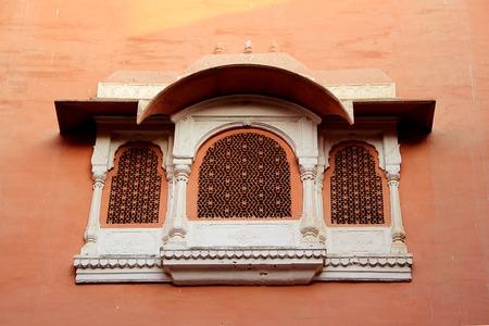 bikaner: Concrete window frame with intricate design on red wall at Junagarh Fort, Bikaner, Rajasthan, India, Asia
