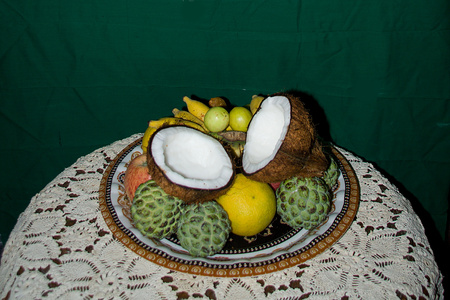 Offering of fruits and coconut shells in a tray placed on table covered with knitted cloth during Lakshmi Puja Festival in India, Asia Stock Photo