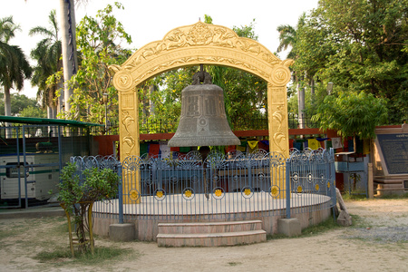 Framework supporting huge prayer bell at Saranath near Varanasi, Uttar Pradesh, India, Asia