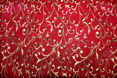 red bed: Red bed spread fabric laced with silver thread floral design Stock Photo