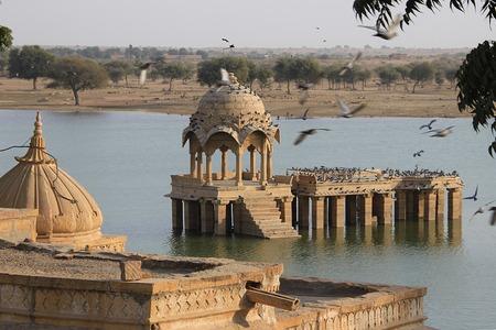 Stone built viewing gallery and platform at Gadisar Lake in Jaisalmer, Rajasthan, India, Asia