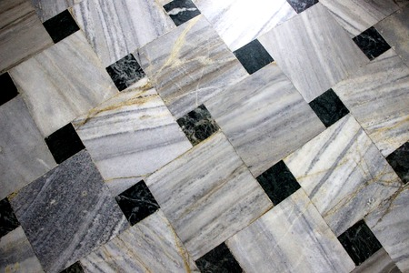 Flooring Inlay work of black and white marble square tiles