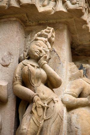 Statue of lady immersed in deep thought at Kandariya Mahadev Temple, under Western Group of Temples, Khajuraho, Madhya Pradesh, India, Asia